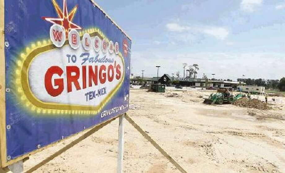 Construction personnel work on the site of the new Gringo's Mexican Kitchen in Spring Thursday. The location will be open around September and employ around 140 positions.