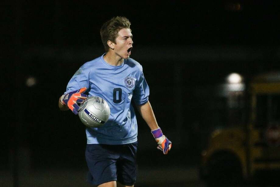 College Park's Austin Heath (0) reacts after making a save during a high school boys soccer game against Conroe on Friday at College Park High School. To view more photos from the game, go to HCNPics.com. Photo: Michael Minasi