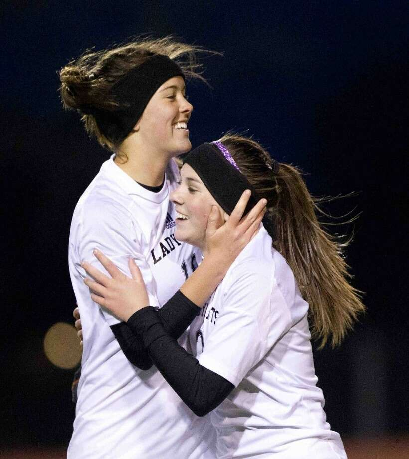 Willis' Summer Massey, right, celebrates with Dominique Veronico after scoring a goal in the first half against Bryan during a girls soccer game Friday. Photo: Jason Fochtman
