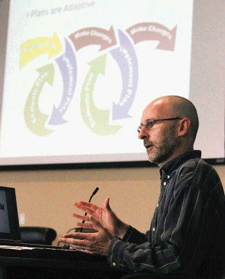 Jason Leifester, project manager with Texas Commission on Environmental Quality, speaks during a public hearing on a proposed study on water quality at the San Jacinto River Authority building Thursday.