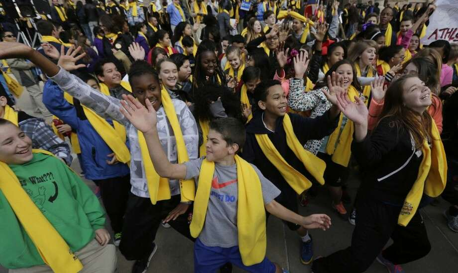 Students dance in front of the Texas Capitol during a school choice rally Friday in Austin. School choice supporters called for expanding voucher programs and charter schools statewide. Photo: Eric Gay