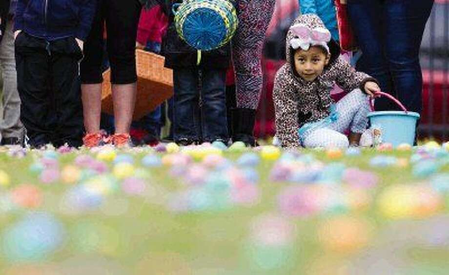 Brianna Galaviz plots her route before an Easter egg hunt at Heritage Park in downtown Conroe Saturday. Go to HCNpics.com to purchase this photo and others like it. Photo: Jason Fochtman