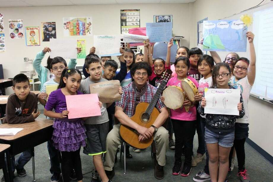 Cannan Elementary students with bi-lingual instructor Alvaro Forero.