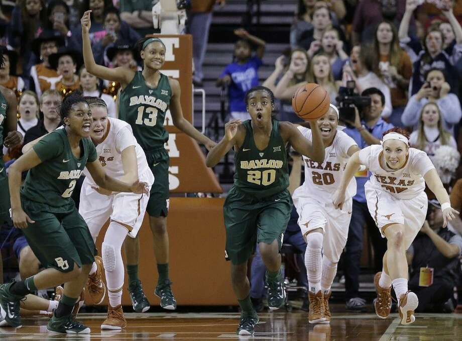 Baylor's Imani Wright (20) lets the final seconds of the clock run out in her team's 70-68 victory over Texas. Second from left is UT's Kelsey Lang, a sophomore from The Woodlands who had 20 points and 10 rebounds. Photo: Eric Gay