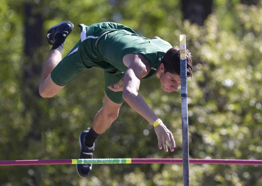 The Woodlands' Logan Jorgensen, Ryan Bourgeois and Cole Saleh competed in the boys pole vault during a a track and field meet at College Park High School Saturday. Photo: Jason Fochtman