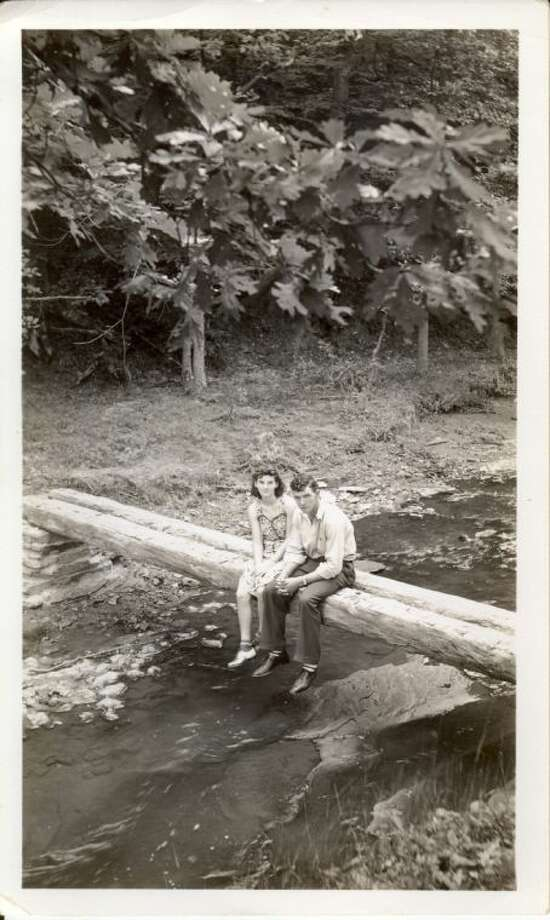 In this September 1940 photo provided by Dick Felumlee, Kenneth and Helen Felumlee of Nashport in central Ohio are shown sitting on a log north of Zanesville about four years before their marriage. The Felumlees, who celebrated their 70th wedding anniversary in February, died 15 hours apart from each other last week.