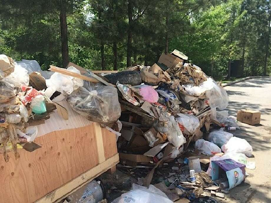 Travis Mabry, owner of TNT Waster Container Services, said since he wasn't paid for his services, he took his waste container and left the trash behind a Woodlands-area pizza restaurant.