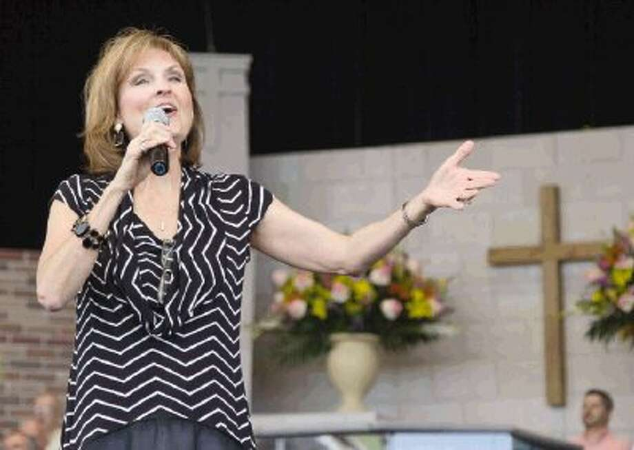 Sandi Lewis sings during Easter at the Pavilion, an event presented by The Woodlands First Baptist Church, at The Cynthia Woods Mitchell Pavilion Sunday. A program titled Renewed began at 10 a.m. and was hosted by First Baptist's senior pastor, Dr. R. Bruce Webb. / Conroe Courier