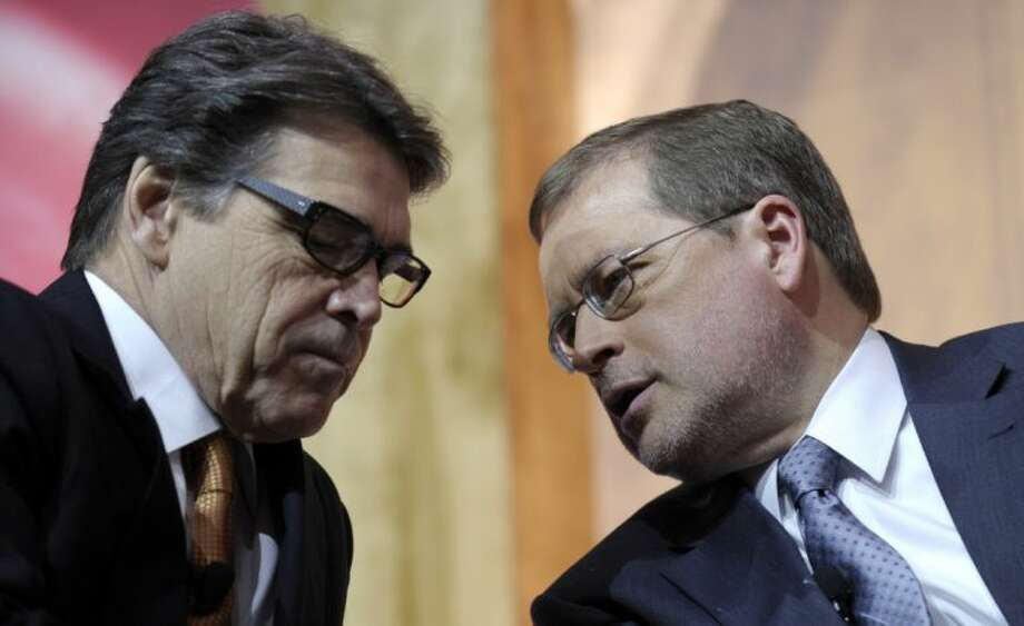 In this March 7, 2014 file photo Texas Gov. Rick Perry, left, talks with Americans for Tax Reform President Grover Norquist, right, before participating on a panel discussion at the Conservative Political Action Committee annual conference in National Harbor, Md. Perry has spent a record 14 years in office, but with eight months left he is now the focus of a grand jury investigation over a veto last summer. Photo: Susan Walsh
