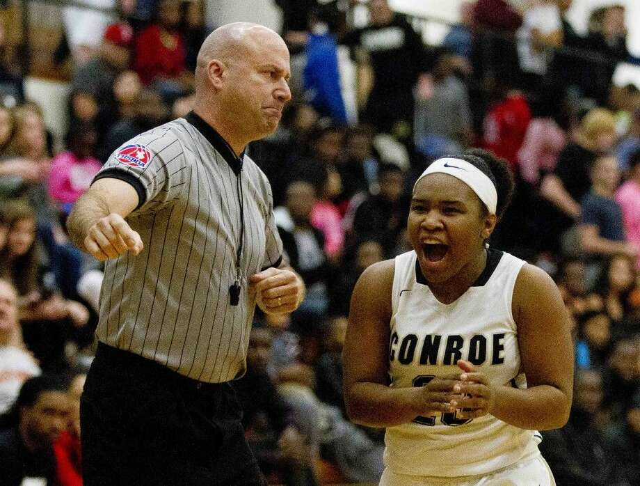 Conroe point guard Erica Powell celebrates during the first half of a girls basketball game this past December. Photo: Jason Fochtman