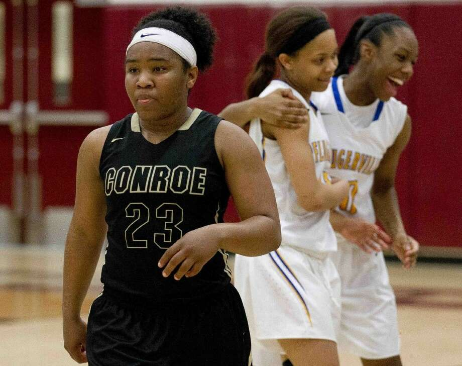 Conroe point guard Erica Solomon-Powell reacts after losing to Pflugerville 52-44 in a Region II-6A area playoff game at A&M Consolidated High School Friday. To purchase this photos, and others like it; go to HCNpics.com. Photo: Jason Fochtman
