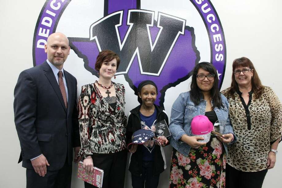 Pictured from left are Superintendent Tim Harkrider, Lucas teacher Michele Reed with Secondary Student of the Month Akerah Gardin and Elementary Student of the Month Nicole Cortes with Meador teacher Aileen Ripkowski.