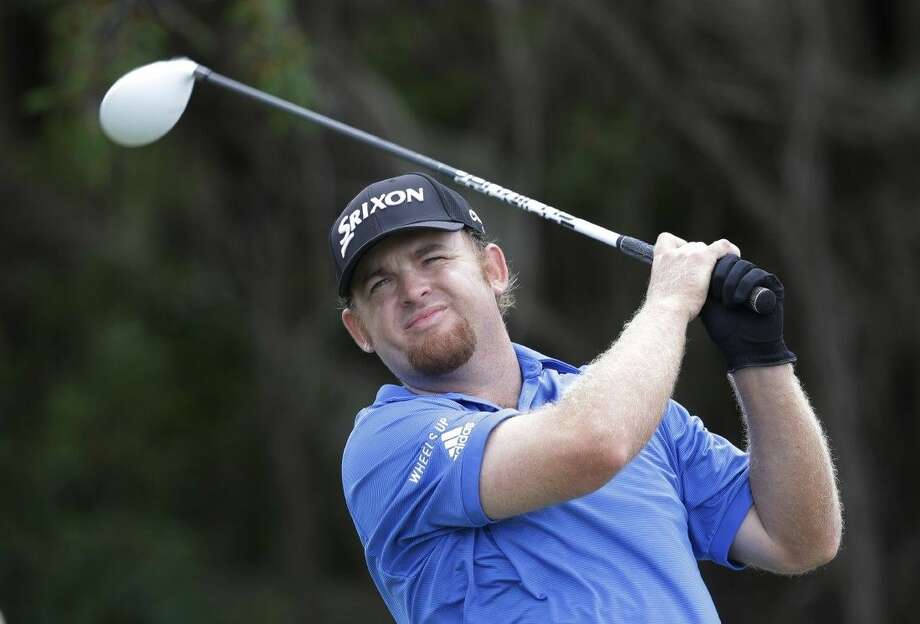 J.B. Holmes hits from the fifth tee during the third round of the Cadillac Championship on Sunday in Doral, Fla.