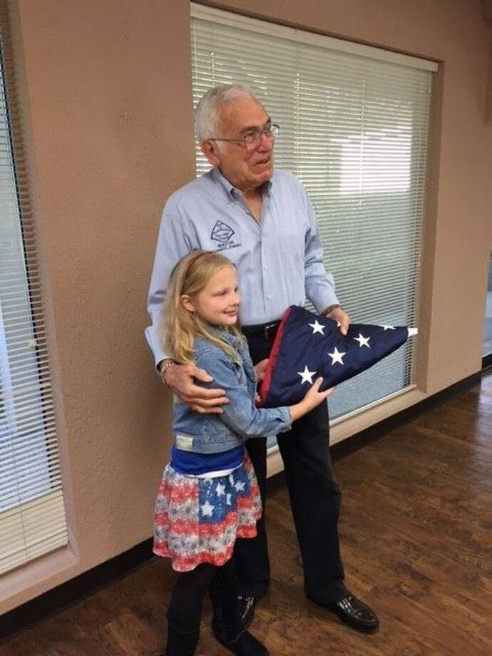 Lena King presents a U.S. Flag flown over the U.S. Capitol to Panorama Village Mayor Howard Kravetz.
