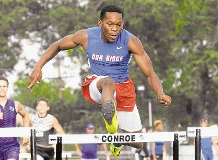 Oak Ridge's Patrick Prince competes in the 300-meter hurdles Thursday at Buddy Moorhead Memorial Stadium. Photo: Keith MacPherson