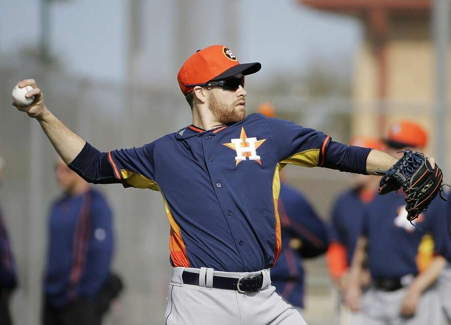 Houston Astros pitcher Collin McHugh throws during a spring training workout Saturday in Kissimmee, Fla.