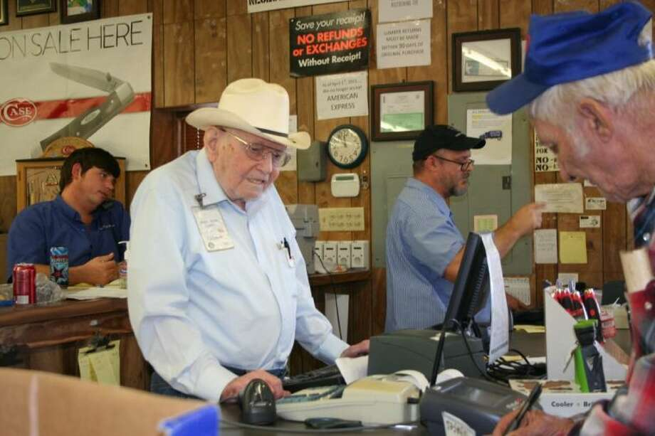 Coleman King rings up customers and strikes up conversations at his Potetz Home Center job. Photo: STEPHANIE BUCKNER
