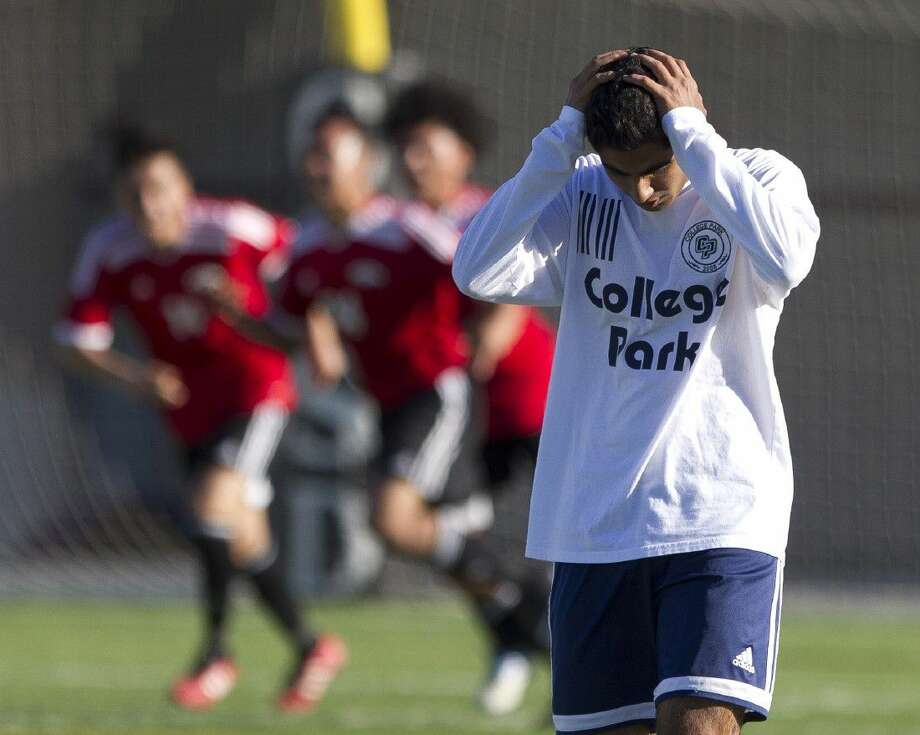 Gaider Hussain of College Park reacts after goal by Juan Patino of Westfield in the second period of a Region II-6A bi-district playoff game at Woodforest Bank Stadium Thursday. Photo: Jason Fochtman