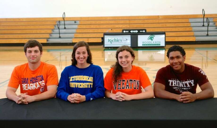 From left to right, The Woodlands Christian student-athletes Michael Sacks, Rachel Earle, Katy Adams and Tristian Suayan celebrated their college signings on Wednesday. Sacks will play football for Sam Houston State, Earle will play volleyball at LeTourneau, Adams will run cross country at Wheaton and Suayan will play football at Trinity.