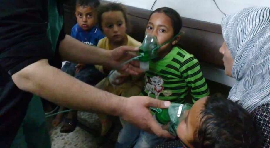 In this image taken from video obtained from the Shaam News Network, posted on April 16, 2014, an anti-Bashar Assad activist group, which has been authenticated based on its contents and other AP reporting, children are seen receiving oxygen in Kfar Zeita, a rebel-held village in Hama province some 200 kilometers (125 miles) north of Damascus. Syrian opposition activists and other witnesses tell The Associated Press that Syrian government forces have attacked rebel-held areas with poisonous chlorine gas in recent months. They say the attacks left scores of men, women and children coughing, choking and gasping for breath. The reports have been denied by the Syrian government and have yet to be confirmed by any foreign country or international organization. But if true, they highlight the limitations of the global effort to rid Syria of its chemical weapons. Photo: Uncredited
