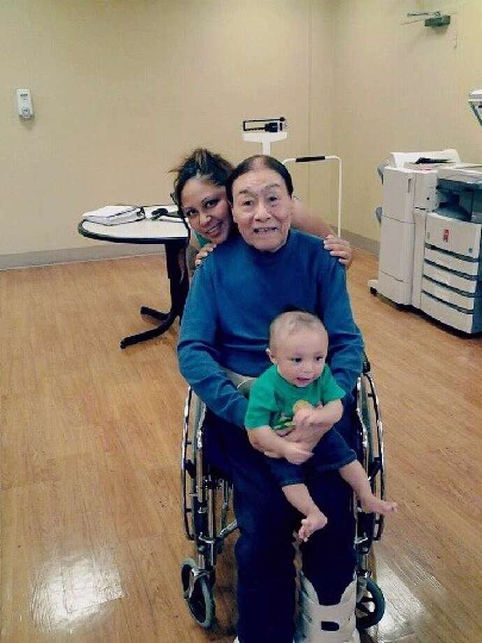 This image provided by Sergio Godoy shows his sister Janet Godoy, rear, grandfather Antonio Acosta and Janet Godoy's son Juan Manuel Gonzalez. Police say a resident of a Houston nursing home will face capital murder charges for using the armrest of his wheelchair to beat two of his roommates, including Acosta, to death.