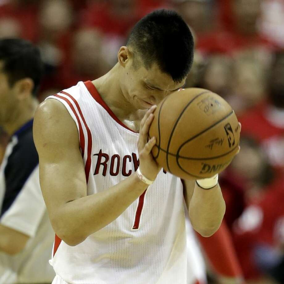 Houston Rockets' Jeremy Lin (7) reacts after a foul call against the Portland Trail Blazers during the fourth quarter in Game 2 of an opening-round NBA basketball playoff series Wednesday, April 23, 2014, in Houston. Portland won 112-105. (AP Photo/David J. Phillip)