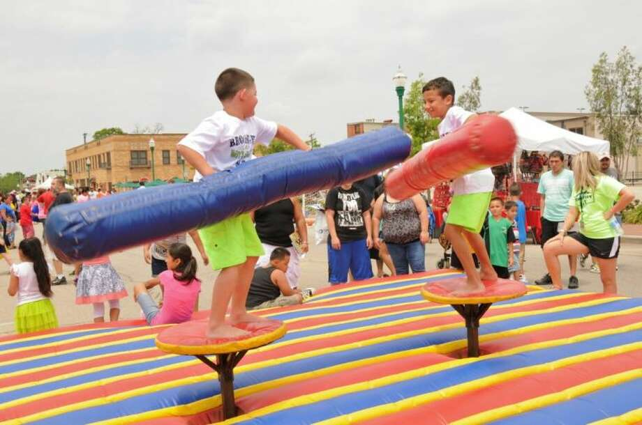 Two youngsters are involved in a jousting contest at the 2013 Conroe Kidzfest in downtown Conroe. The 2014 KidzFest is scheduled for Saturday 10 a.m. to 2 p.m.