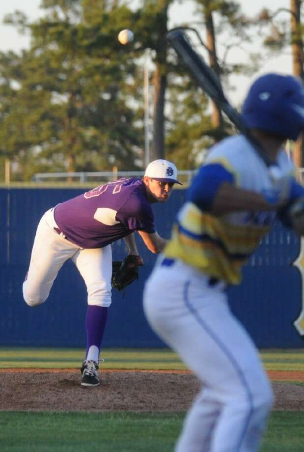 Montgomery's Collin Garrett delivers a pitch during a District 15-6A contest against Klein on Monday at Klein High School.