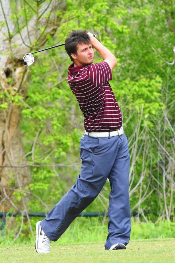 Magnolia's Ryan Burke tees off during the District 19-5A championship River Ridge Golf Course. Photo: Tony Gaines