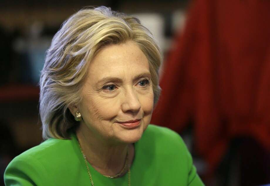 In this April 14 photo, Democratic presidential candidate Hillary Rodham Clinton meets with local residents at the Jones St. Java House in LeClaire, Iowa. The board of the Clinton Foundation says it will continue accepting donations from foreign governments but only six nations, a move aimed at insulating presidential candidate Hillary Rodham Clinton from controversies over the charity's reliance on millions of dollars from abroad. Photo: Charlie Neibergall