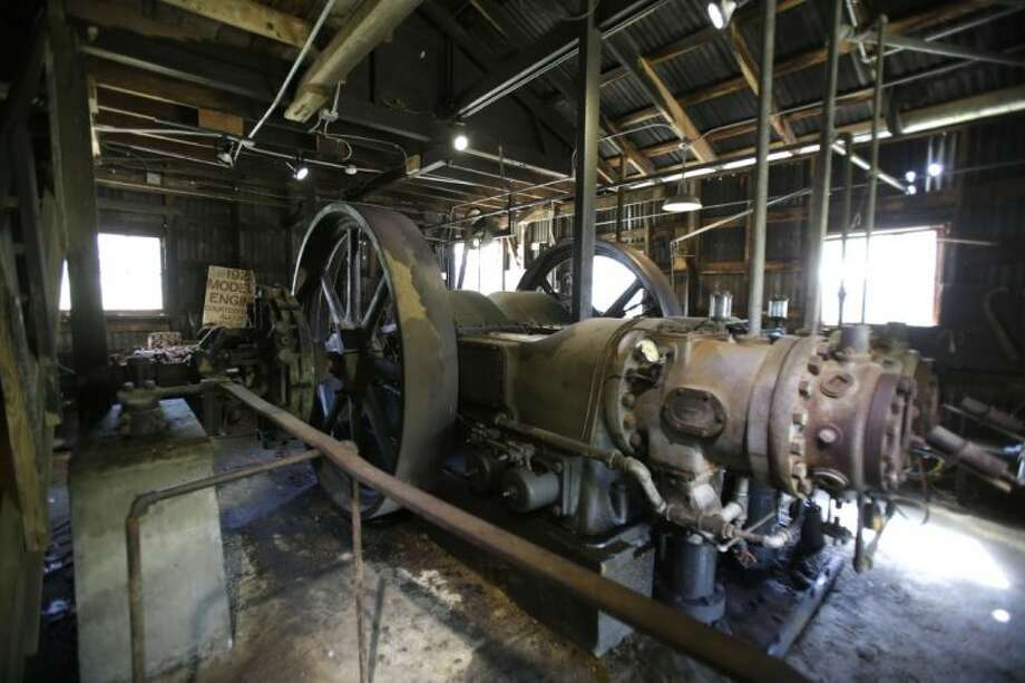 This Wednesday photo shows an old Bessemer diesel engine, which is still in working order, at the Burton Farmers Gin in Burton. The facility has the oldest working gin in the country at 100 years old.