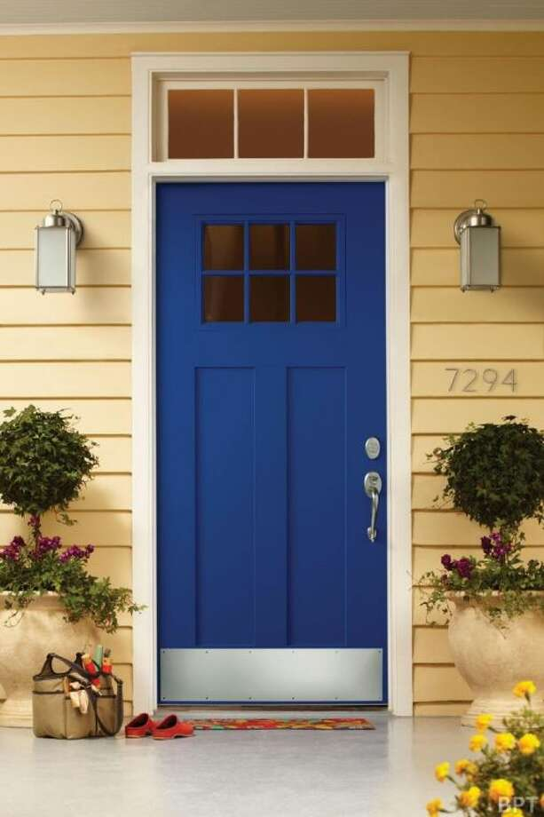 This year, go bold with your color choice when painting the front door — try coral, tomato red, teal, aqua, violet, pistachio and cobalt.