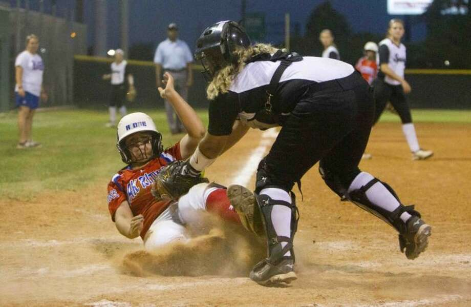 Oak Ridge's Veronica Villafranco beats the tag from Spring catcher Baley Brinker to score one of the Lady War Eagles' 10 runs in the inning during Game 2 of a high school softball bi-district playoff series at Spring High School Friday. To view or purchase this photo and others like it, visit HCNpics.com. Photo: Jason Fochtman