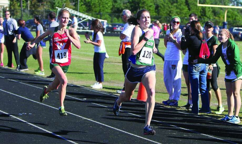 College Park's Georgia Burner, right, is currently Montgomery County's top 800-meter dash runner.
