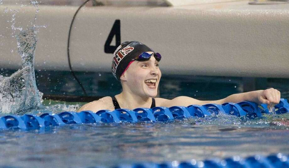 Magnolia's Caitlin Clements celebrates after finishing first in the girls 100-yard freestyle during the finals of the Class 5A UIL State Swimming and Diving Championships in Austin Saturday. Photo: Jason Fochtman