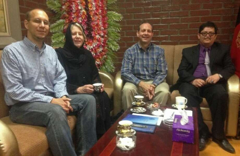 This photo taken on April 22 shows from left, slain American John Gabel, his mother, his father Gary Gabel sitting with Mohammad Hadi Hadayati, Kabul University's vice chancellor at Kabul University, in Kabul, Afghanistan.