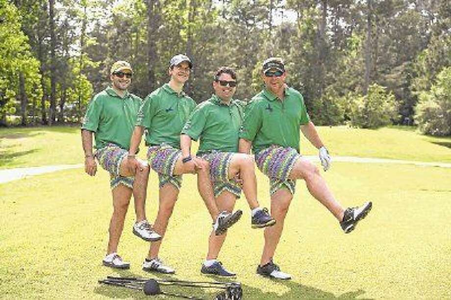Marc Atnipp, pictured third from left, and his team won the 2015 HOPE on the Green Crazy Pants Contest, one of many features offered to make the tournament unique. The limit for players is 216, and registration is already at 75 percent capacity. Photo: Jen McDonald