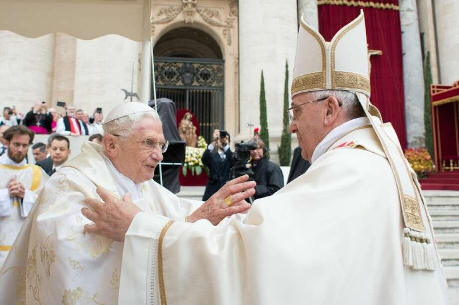 In this photo provided by the Vatican newspaper L'Osservatore Romano, Pope Francis, right, embraces his predecessor Pope Emeritus Benedict XVI, during a ceremony in St. Peter's Square at the Vatican, Sunday. Photo: Uncredited