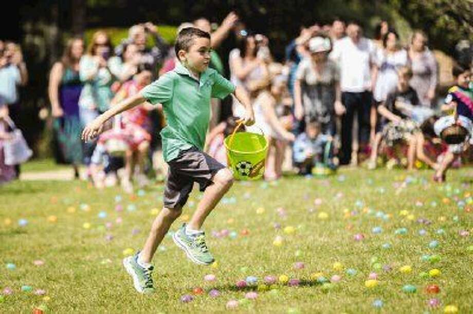 Nine-year-old Michael Sirincione, of The Woodlands, sprints to the middle of the field during an Easter Day egg hunt on Saturday at the Woodlands Church. 8,000 eggs were snatched up by hundreds of kids in 37 seconds. Photo: Michael Minasi