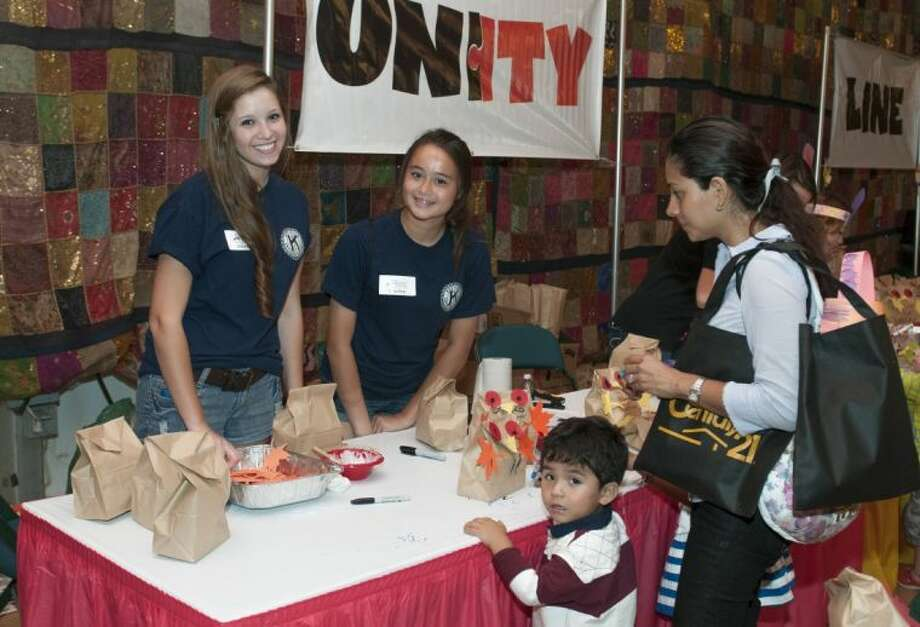Two students (pictured on the left) from Oak Ridge High School Key Club volunteered at The Cynthia Woods Mitchell Pavilion's Children's Festival last year. The Pavilion is currently recruiting community service organizations and businesses to volunteer at the Festival Nov. 7-10.