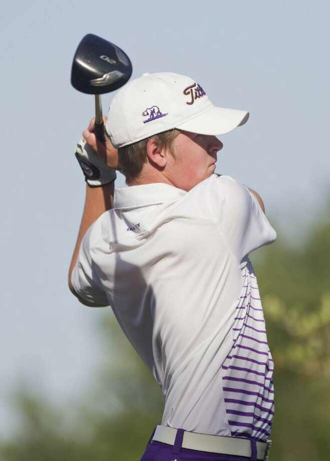 Montgomery's Ethan Edsall tees off the first hole during the UIL State Golf Championships in Austin Monday. To view or purchase this photo and others like it, visit HCNpics.com. Photo: Jason Fochtman