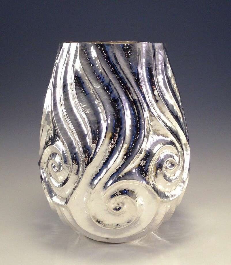 """A raised silver vessel titled """"Winter Tide,"""" by Nile and Michelle Fahmy, a brother-and-sister metal art-making team selected as the """"Spotlight Artists"""" for this year's Woodlands Waterway Arts Festival, set for April 8-10."""