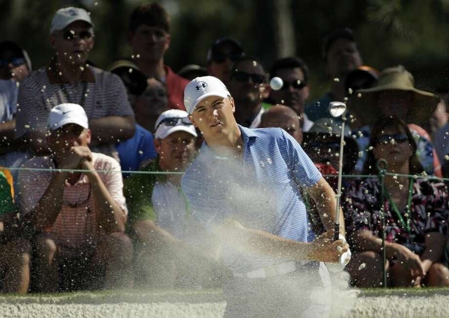 Jordan Spieth watches his hit out of a bunker at the seventh hole during the third round of the Masters golf tournament Saturday in Augusta, Ga. Photo: David J. Phillip