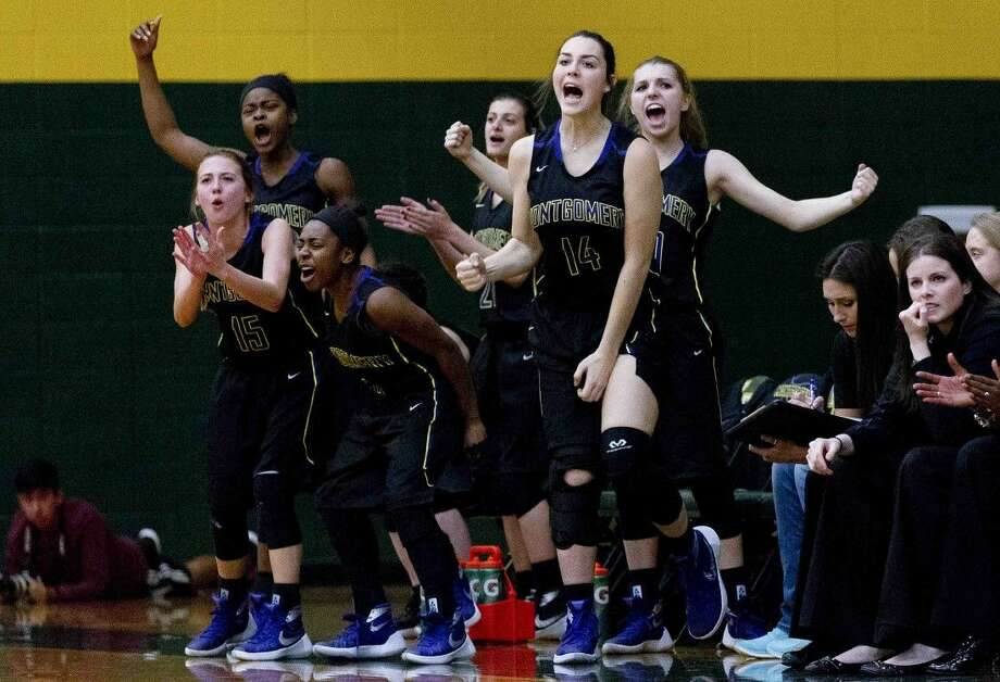 The Montgomery bench celebrates a 3-pointer in the first quarter of a District 15-6A girls basketball game at Klein Forest High School Tuesday. To purchase this photos and others like it, go to HCNpics.com. Photo: Jason Fochtman