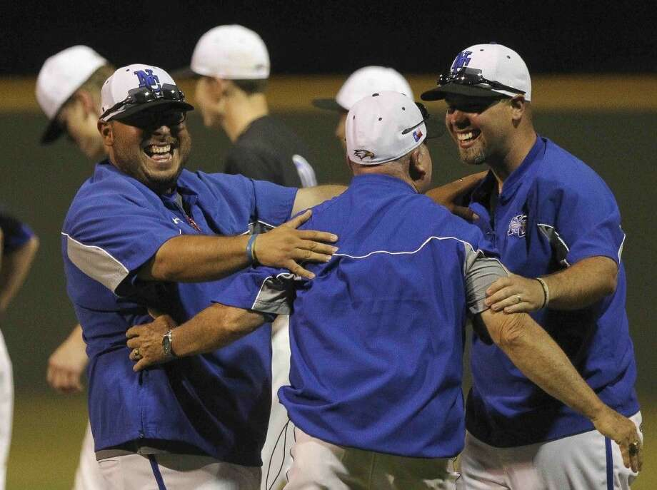 New Caney coaches celebrate after the Eagles rallied to defeat Porter 4-3 in a District 21-5A baseball game at Porter High School Wednesday. Photo: Jason Fochtman
