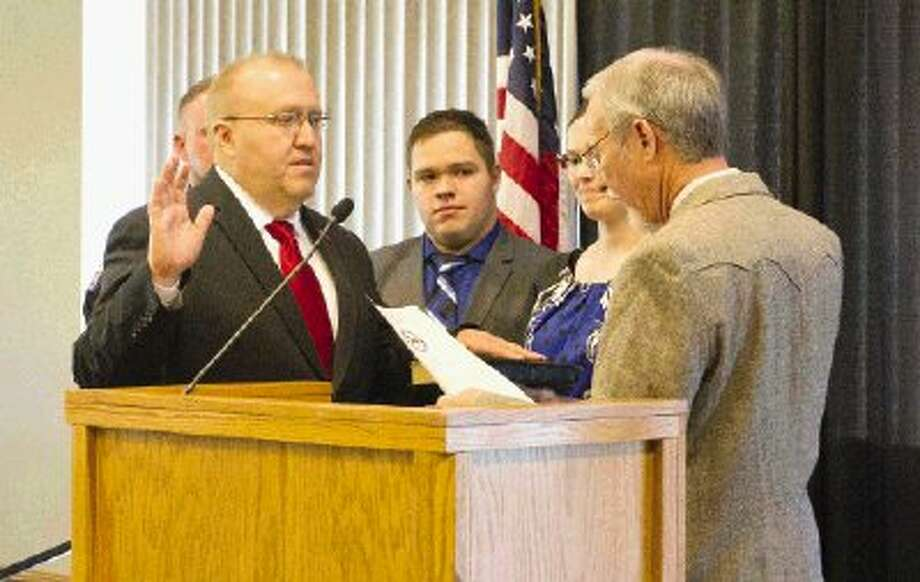 New Justice of the Peace Pct. 1 Wayne Mack is sworn into office Thursday morning to a crowd of over 300 at the Lone Star Convention Center. Photo: Jason Fochtman / Conroe Courier / HCN