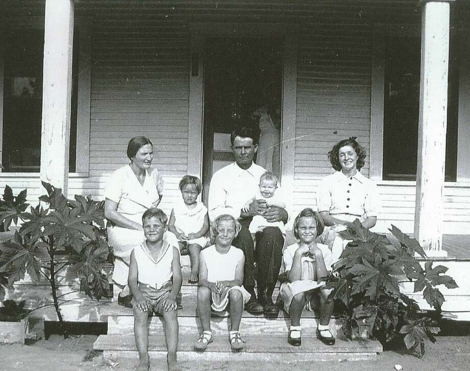 The L.O. (Lewis Ory) Gundy family on the front porch of their farm home when it was located on FM 2854. The photo was taken in the summer of 1934. Pictured in the top row are Bettie, Lois, Lewis holding Betty and Dorothy. Bottom row twins Lewis and Louise are pictured along with daughter Julia. The home in the picture is now the Cozy Supper Club in Montgomery.