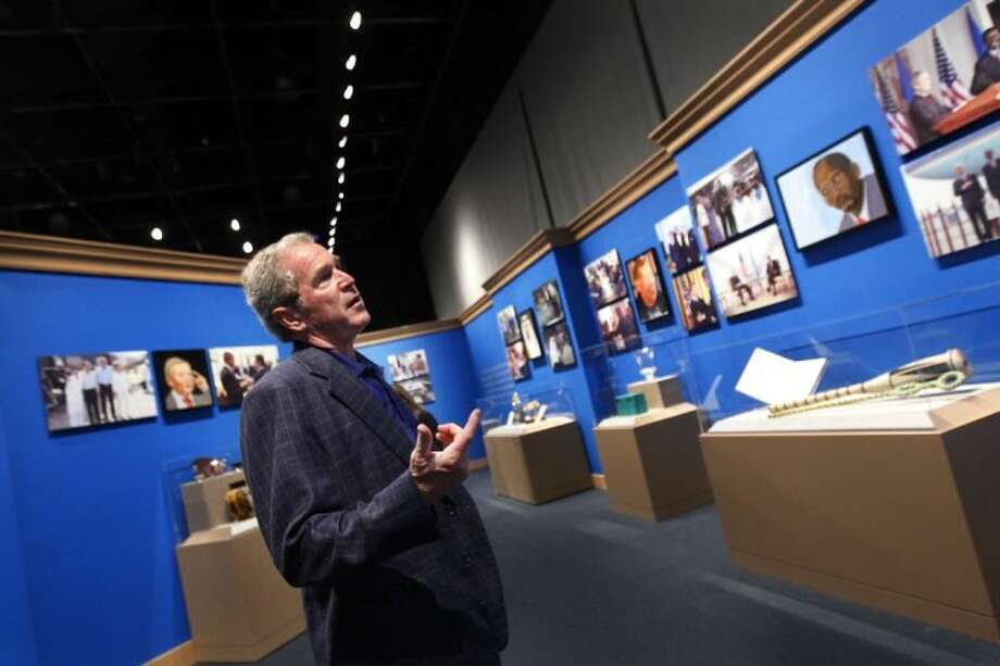 "In this Tuesday, April 1, 2014, file photo, Former President George W. Bush tours his new exhibit, ""The Art of Leadership: A President's Personal Diplomacy"" at the George W. Bush Presidential Library and Museum in Dallas. Photo: Mona Reeder"