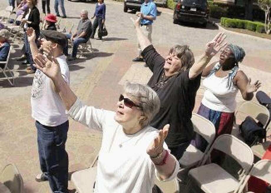 Worshippers sing during a National Day of Prayer event at the Montgomery County Courthouse Thursday. Go to HCNpics.com to view more photos from National Day of Prayer. Photo: Jason Fochtman / Conroe Courier / HCN