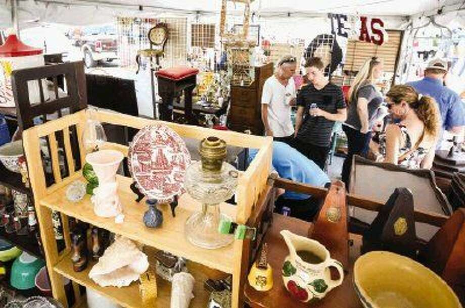 Attendees walk among vendors during the 16th annual Antiques Festival on Saturday in downtown Montgomery. Photo: Michael Minasi